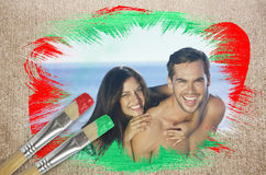 Composite image of attractive couple at the beach Stock Image