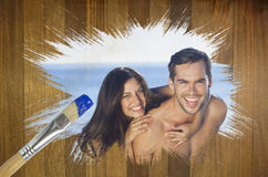 Composite image of attractive couple at the beach Royalty Free Stock Image
