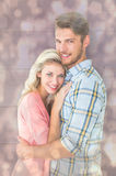 Composite image of attractive couple embracing and smiling at camera Stock Photo