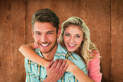 Composite image of attractive couple embracing and smiling at camera Stock Photography