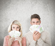 Composite image of attractive couple flashing their cash Royalty Free Stock Photos