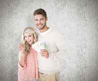 Composite image of attractive couple flashing their cash Stock Photography