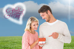 Composite image of attractive couple holding miniature house model Stock Photos