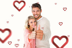 Composite image of attractive couple showing thumbs up to camera. Attractive couple showing thumbs up to camera against hearts Stock Images