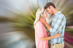Composite image of attractive couple smiling at each other and hugging Stock Photos