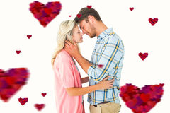 Composite image of attractive couple smiling at each other and hugging Royalty Free Stock Photos