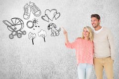 Composite image of attractive couple smiling and walking Stock Photos