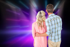 Composite image of attractive couple standing and looking Royalty Free Stock Photos