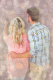 Composite image of attractive couple standing and looking Stock Photo