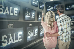 Composite image of attractive couple standing and looking Stock Image