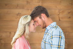 Composite image of attractive couple standing touching heads Stock Images