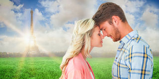 Composite image of attractive couple standing touching heads Stock Image