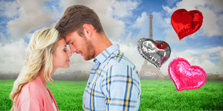 Composite image of attractive couple standing touching heads royalty free stock photo