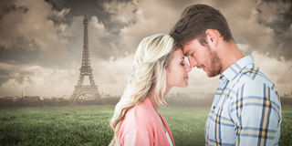 Composite image of attractive couple standing touching heads Royalty Free Stock Images