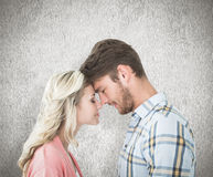Composite image of attractive couple standing touching heads Stock Photos