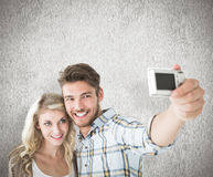 Composite image of attractive couple taking a selfie together Stock Image