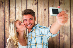 Composite image of attractive couple taking a selfie together Royalty Free Stock Photography