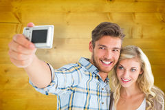 Composite image of attractive couple taking a selfie together Stock Photos