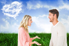 Composite image of attractive couple talking about something shocking Stock Images