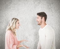 Composite image of attractive couple talking about something shocking Stock Photo