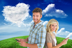 Composite image of attractive couple using their smartphones Royalty Free Stock Photos