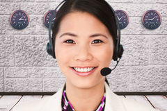 Composite image of attractive female engineer smiling at the camera Stock Photography