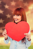 Composite image of attractive hipster woman behind a red heart Stock Photo