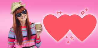 Composite image of attractive hipster woman holding a cup of coffee Royalty Free Stock Photo