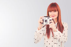 Composite image of attractive hipster woman using old fashioned camera Royalty Free Stock Image