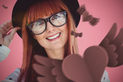 Composite image of attractive smiling hipster woman with hat Stock Photos