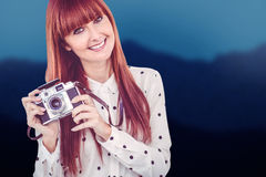 Composite image of attractive smiling hipster woman with old fashioned camera Stock Photos