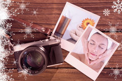 Composite image of attractive woman receiving facial massage at spa center. Attractive woman receiving facial massage at spa center against lighted candles with Stock Photo