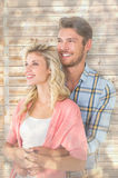 Composite image of attractive young couple embracing and smiling. Attractive young couple embracing and smiling against light glowing dots design pattern Stock Photography