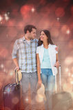 Composite image of attractive young couple going on their holidays Stock Photo