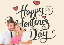 Composite image of attractive young couple holding pink heart. Attractive young couple holding pink heart against happy valentines day stock photos
