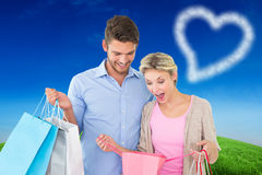 Composite image of attractive young couple holding shopping bags Royalty Free Stock Image