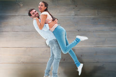 Composite image of attractive young couple hugging each other Stock Photo