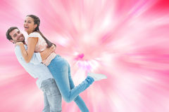Composite image of attractive young couple hugging each other Royalty Free Stock Images