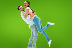 Composite image of attractive young couple hugging each other Stock Image