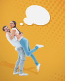 Composite image of attractive young couple hugging each other Royalty Free Stock Photos