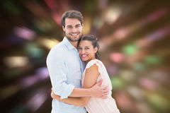 Composite image of attractive young couple hugging and smiling at camera. Attractive young couple hugging and smiling at camera against valentines heart design Royalty Free Stock Photography