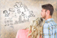 Composite image of attractive young couple looking together Royalty Free Stock Images