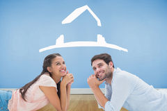 Composite image of attractive young couple looking up Stock Image