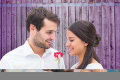 Composite image of attractive young couple lying down Royalty Free Stock Photo
