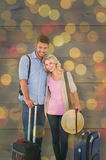 Composite image of attractive young couple ready to go on vacation Stock Image