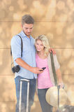 Composite image of attractive young couple ready to go on vacation Royalty Free Stock Images
