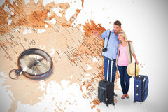 Composite image of attractive young couple ready to go on vacation Royalty Free Stock Photo