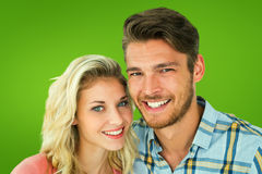 Composite image of attractive young couple smiling at camera Royalty Free Stock Image