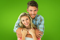 Composite image of attractive young couple smiling at camera Royalty Free Stock Photos