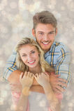 Composite image of attractive young couple smiling at camera Royalty Free Stock Photo